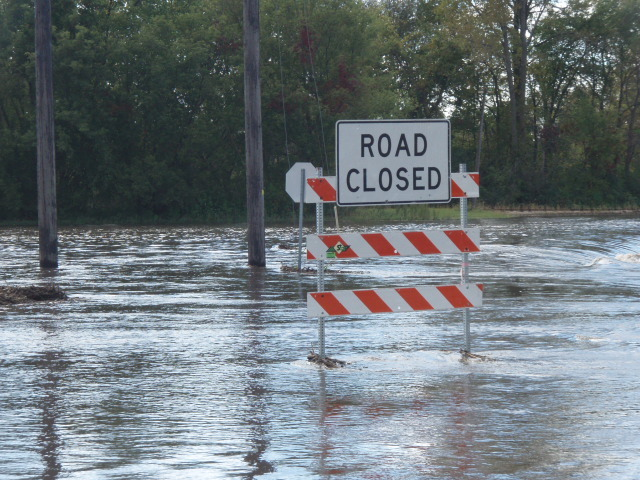 Road Closed Sign on a Flooded Road