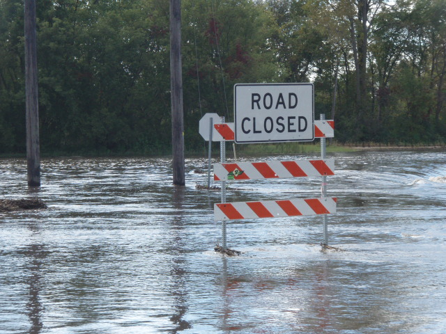 Road Closed sign with flood water at the foot of the sign
